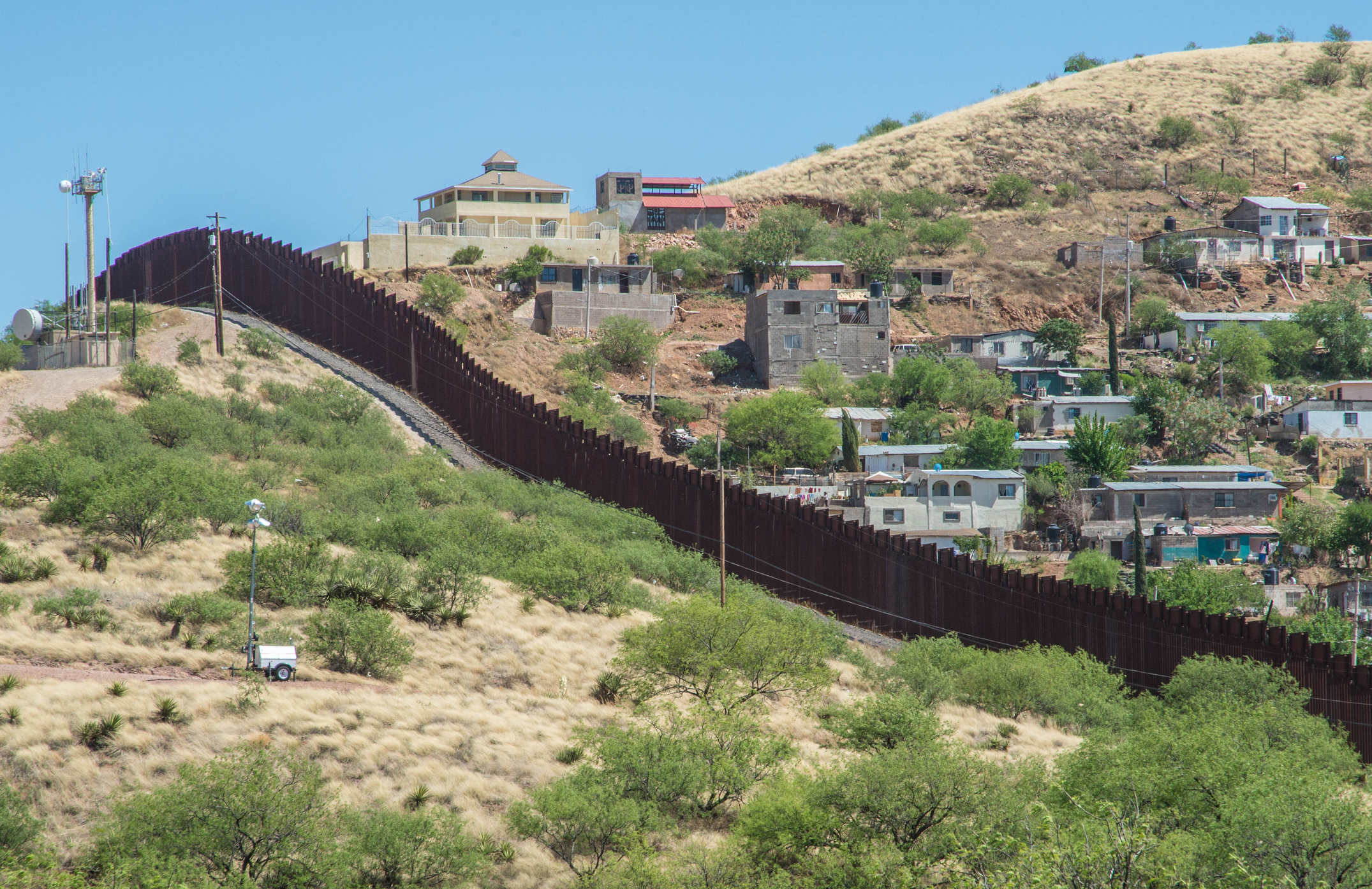 Border fence looking from Nogales Arizona into Nogales in Sonora Mexico